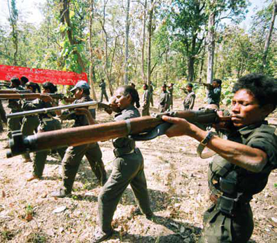 Women Maoists cadres doing weapons training